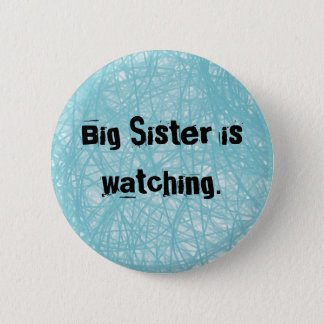 Big Sister is watching. Round blue button