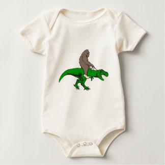 Bigfoot riding T Rex Baby Bodysuit