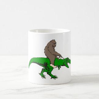Bigfoot riding T Rex Coffee Mug