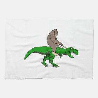 Bigfoot riding T Rex Kitchen Towel
