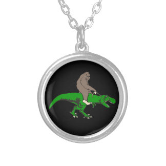 Bigfoot riding T Rex Silver Plated Necklace