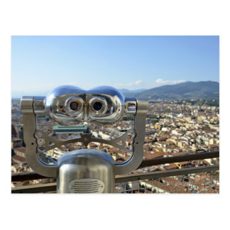 Binoculars overlooking Florence cityscape, top Postcard