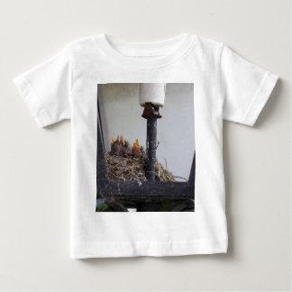 Bird nest in a street lamp. baby T-Shirt