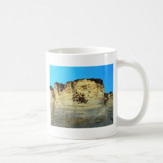 bird nests on rock face classic white coffee mug