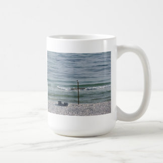 Bird on Wooden Cross by the Ocean Coffee Mug