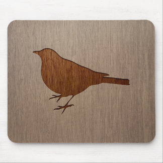 Bird silhouette engraved on wood design mouse pad
