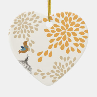 Bird singing outside the cage ceramic heart ornament
