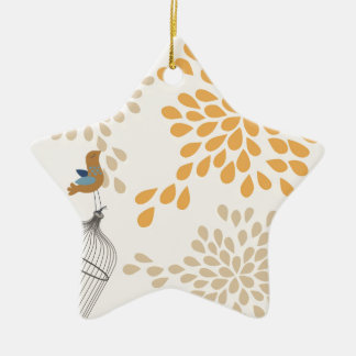 Bird singing outside the cage ceramic star ornament