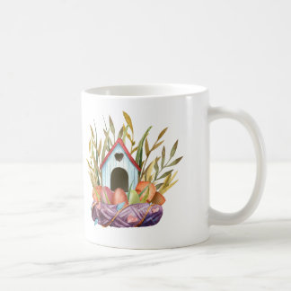 birdhouse on nest coffee mug