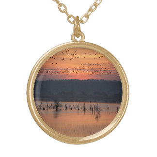 Birds at sunrise gold plated necklace