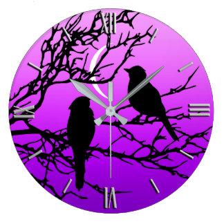Birds on a Branch, Black Against Twilight Purple Wall Clocks