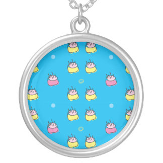 Birthday cake pattern on blue. silver plated necklace