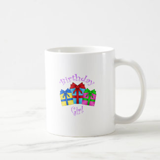 Birthday girl in purple with presents coffee mugs