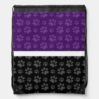 Black and purple dog paw print backpack