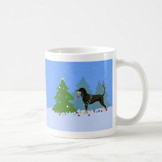 Black and Tan Coonhound Decorating Christmas Tree Coffee Mug
