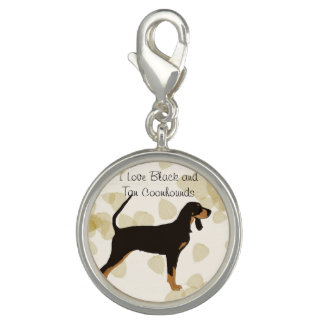 Black and Tan Coonhound on Tan Leaves Charm