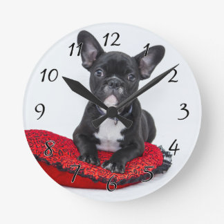Black and White Bulldog Terrier on Red Pillow Round Clock