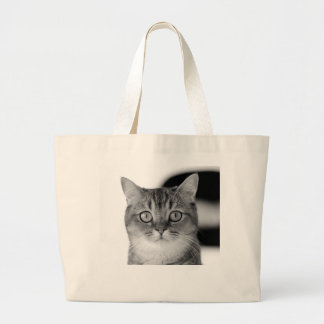 Black and white cat looking straight at you large tote bag