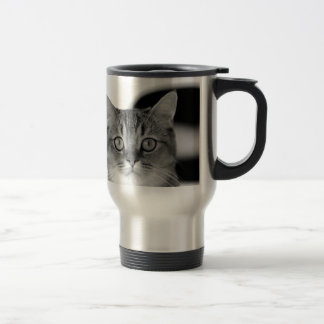 Black and white cat looking straight at you travel mug