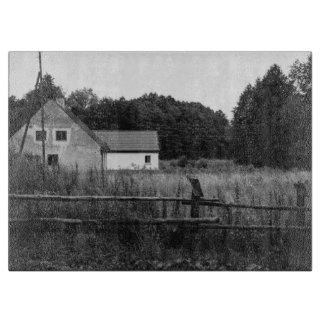 Black and White Farm In A Grassland Landscape Cutting Board
