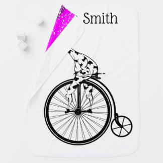 Black and white giraffe riding a bike baby blanket
