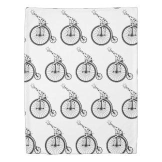 Black and white giraffe riding a bike duvet cover