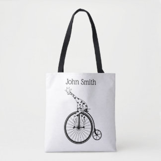 Black and white giraffe riding a bike tote bag