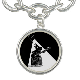 Black and white goat playing an electric guitar bracelets