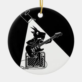 Black and white goat playing an electric guitar round ceramic ornament