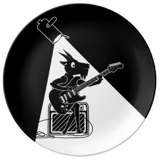 Black and white goat playing guitar plate