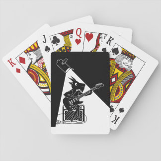 Black and white goat playing guitar playing cards