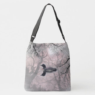 Black and white loon on a lake Cross Bag