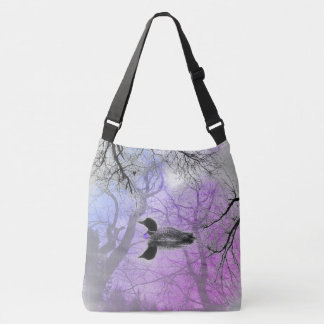 Black and white loon on a lake Cross Bag purple