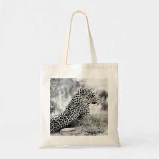 Black and White photo of Leopard looking Tote Bags