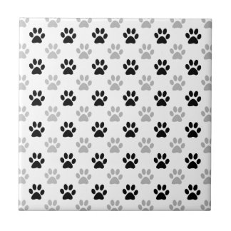 Black and white puppy paw prints tile