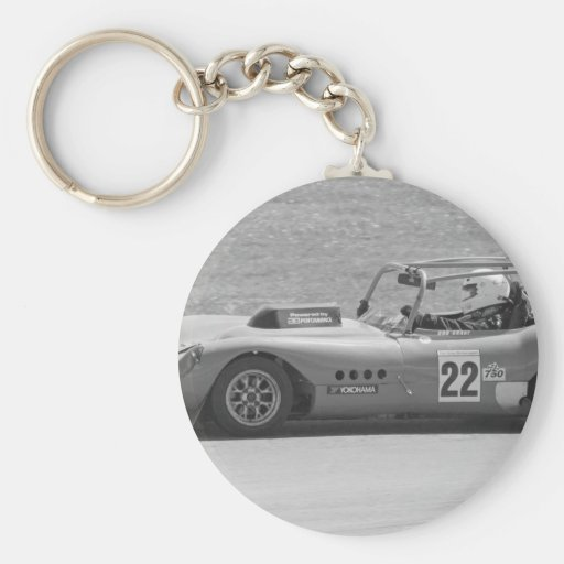Black and white single seater race car keychains