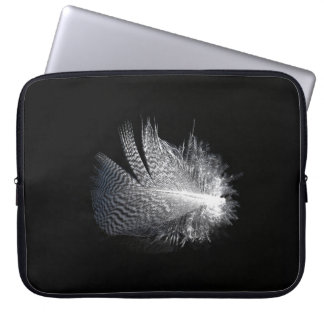 Black and White Striped Feather Floating on a Pond Laptop Sleeve
