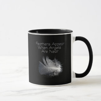Black and White Striped Feather Floating on a Pond Mug