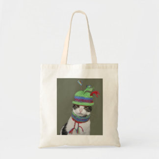 Black and white tabby cat in hat and scarf tote bag