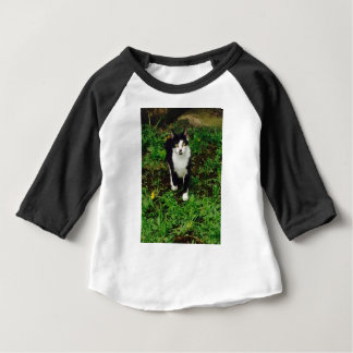 Black and white tuxedo cat in the green grass baby T-Shirt