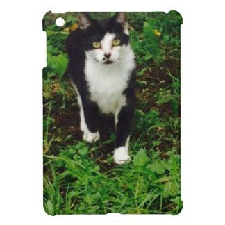 Black and white tuxedo cat in the green grass iPad mini cover
