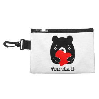 Black bear holding a heart accessory bag