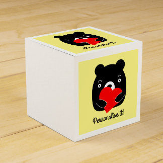 Black bear holding a heart favor box