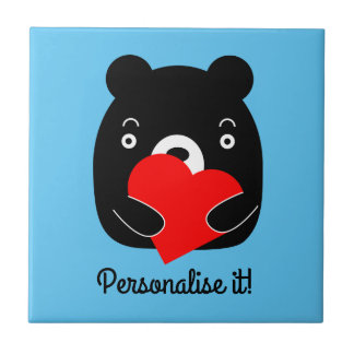 Black bear holding a heart tile