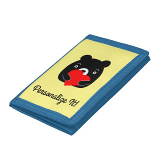 Black bear holding a heart tri-fold wallet