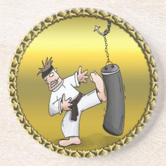 Black belt karate man kicking a black training bag coaster