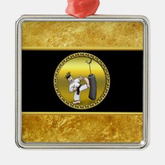 Black belt karate man kicking a black training bag metal ornament