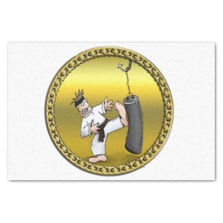 Black belt karate man kicking a black training bag tissue paper