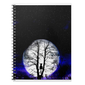 black cat on tree spiral notebook