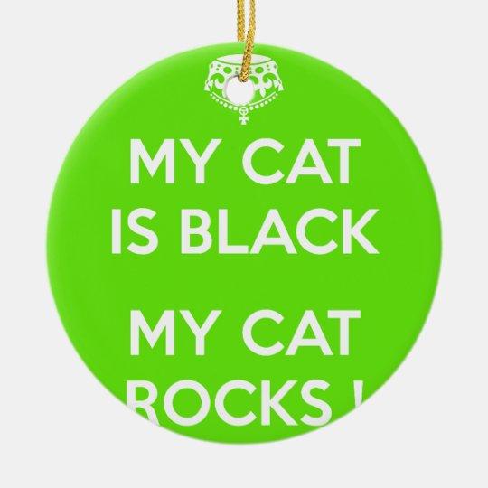 Black cat rocks round ceramic ornament